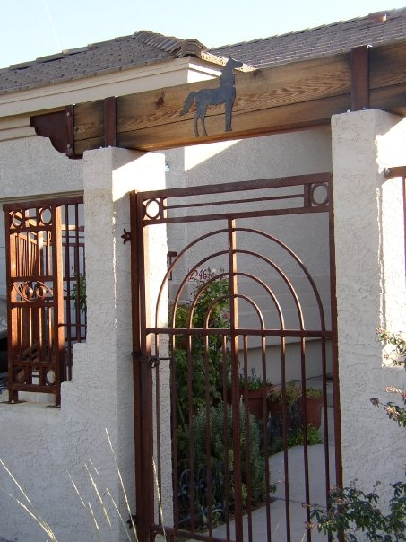 Courtyard gate and fencing.