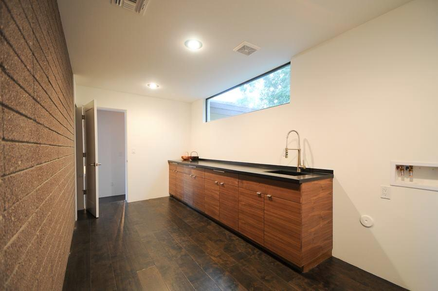 Hot rolled steel for a sink and counter, a window box, a laundry room counter, as well as cladding in the living room.